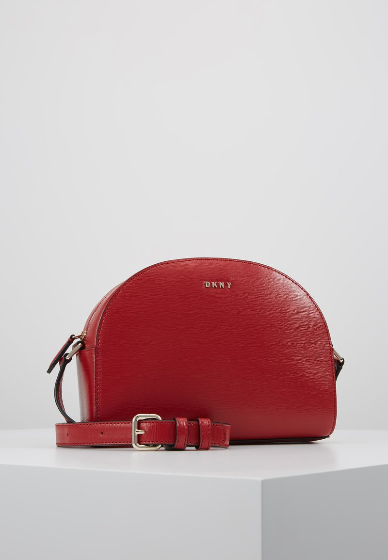 DKNY - SUTTON DOME XBODY - Across body bag - bright red