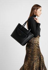 DKNY - ALEXA TOTE SUTTON - Tote bag - black/gold - 1