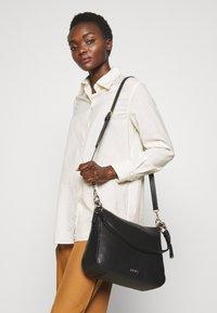 DKNY - DAYSIE  - Handtasche - black/gold-coloured - 1