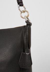 DKNY - DAYSIE  - Handtasche - black/gold-coloured - 6