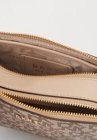DKNY - BRYANT LOGO CAMERA BAG - Across body bag - sand - 5