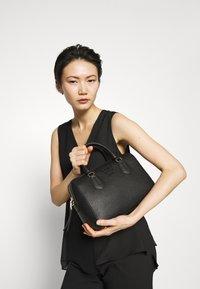 DKNY - NOHO MEDIUM SPEEDY SATCHEL - Handbag - black - 1