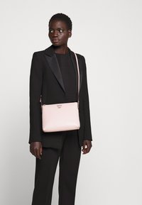 DKNY - WHITNEY FLAT CROSSBODY - Across body bag - light pink - 0