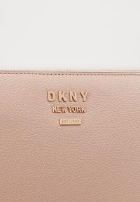 DKNY - WHITNEY FLAT CROSSBODY - Across body bag - light pink - 5