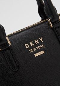 DKNY - WHITNEY MINI DOME SATCHEL - Handbag - black/gold - 5