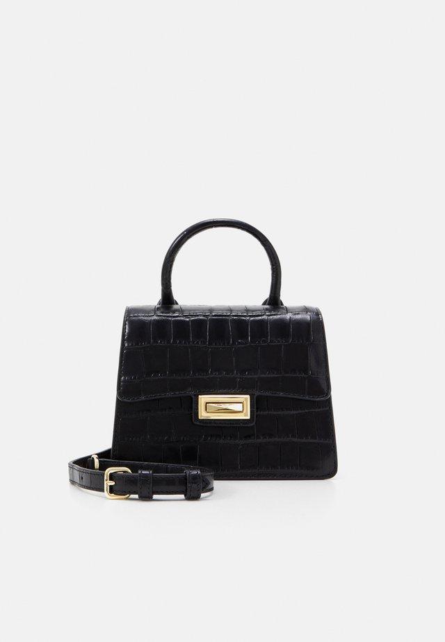 JOJO MINI SATCHEL - Handtasche - black/gold