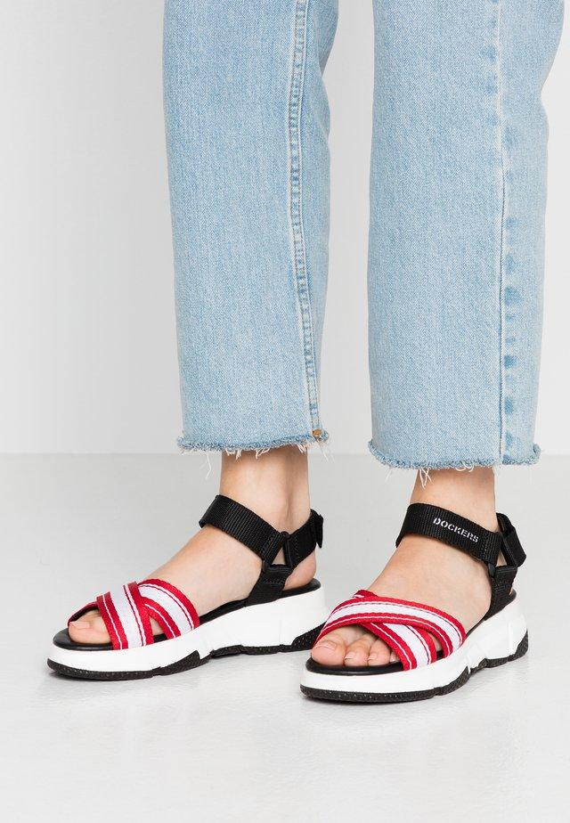 Korkeakorkoiset sandaalit - schwarz/rot