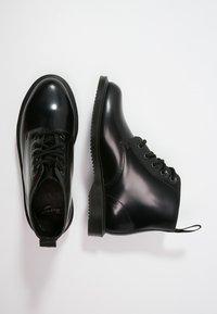 Dr. Martens - EMMELINE - Šněrovací kotníkové boty - black - 1
