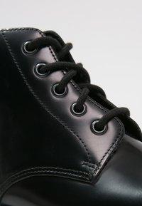 Dr. Martens - EMMELINE - Šněrovací kotníkové boty - black - 5