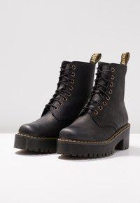 Dr. Martens - SHRIVER HI 8 EYE BOOT - Platform ankle boots - black - 4