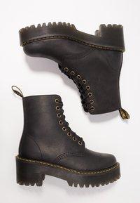 Dr. Martens - SHRIVER HI 8 EYE BOOT - Platform ankle boots - black - 3