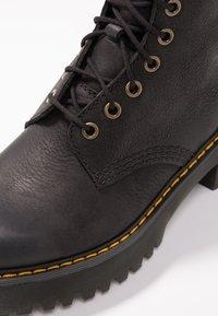 Dr. Martens - SHRIVER HI 8 EYE BOOT - Platform ankle boots - black - 2