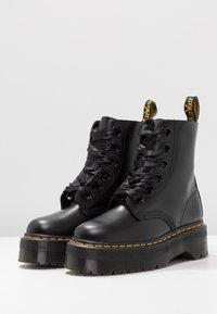 Dr. Martens - MOLLY - Platform ankle boots - black - 4