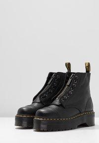Dr. Martens - SINCLAIR - Platform ankle boots - black/aunt sally - 4