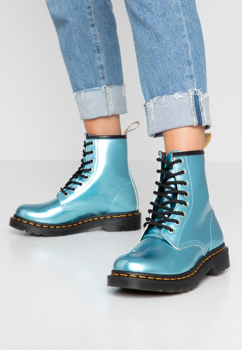 Dr. Martens - 1460 VEGAN 8 EYE BOOT - Lace-up ankle boots - blue/goldmix