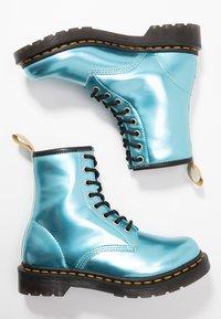 Dr. Martens - 1460 VEGAN 8 EYE BOOT - Lace-up ankle boots - blue/goldmix - 3