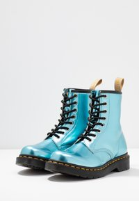 Dr. Martens - 1460 VEGAN 8 EYE BOOT - Lace-up ankle boots - blue/goldmix - 4