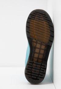 Dr. Martens - 1460 VEGAN 8 EYE BOOT - Lace-up ankle boots - blue/goldmix - 6