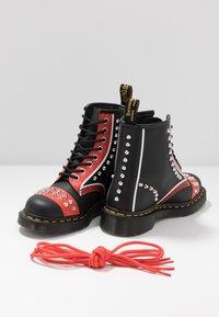 Dr. Martens - STUD 8 EYE BOOT - Cowboy/biker ankle boot - black backhand - 7