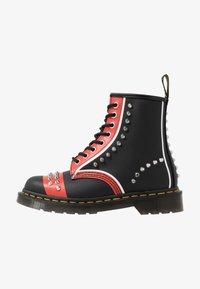 Dr. Martens - STUD 8 EYE BOOT - Cowboy/biker ankle boot - black backhand - 1