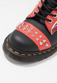 Dr. Martens - STUD 8 EYE BOOT - Cowboy/biker ankle boot - black backhand - 2