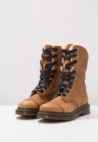 Dr. Martens - AIMILITA 9 EYE TOE CAP BOOT - Lace-up boots - tan - 3