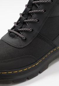 Dr. Martens - BONNY TECH - Lace-up ankle boots - black - 5