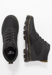 Dr. Martens - BONNY TECH - Lace-up ankle boots - black - 1