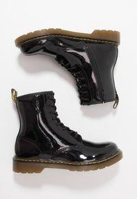 Dr. Martens - 1460 - Lace-up ankle boots - black - 0