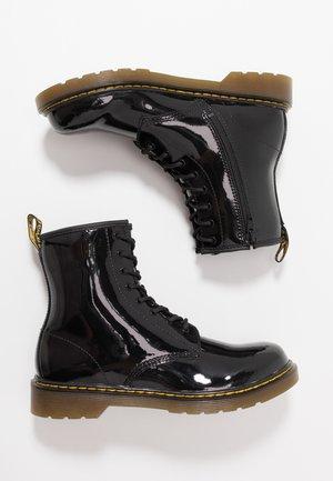 1460 - Šněrovací kotníkové boty - black