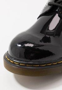 Dr. Martens - 1460 - Lace-up ankle boots - black - 2
