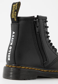 Dr. Martens - 1460 HELLO-KITTY  T - Lace-up ankle boots - black - 6