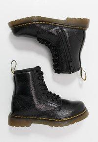 Dr. Martens - 1460 - Lace-up ankle boots - black metallic - 0