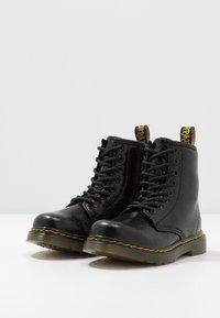 Dr. Martens - 1460 - Lace-up ankle boots - black metallic - 3
