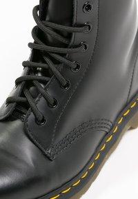 Dr. Martens - Originals 1490 - Lace-up ankle boots - black - 5