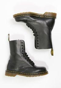 Dr. Martens - Originals 1490 - Lace-up ankle boots - black - 1