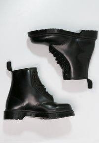 Dr. Martens - 1460 - Lace-up ankle boots - mono black - 1