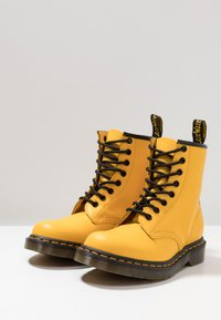 Dr. Martens - 1460 8 EYE BOOT - Lace-up ankle boots - yellow