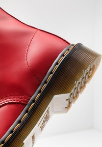 Dr. Martens - 1460 - Lace-up ankle boots - satchel red - 5