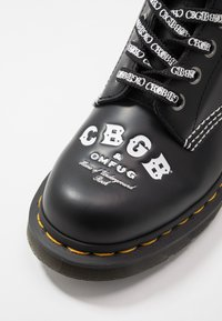 Dr. Martens - 1460 CBGB - Lace-up ankle boots - black - 6
