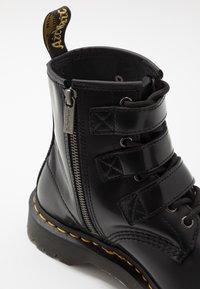 Dr. Martens - 1460 FENIMORE HARDWARE 8 EYE - Cowboy/biker ankle boot - black - 5
