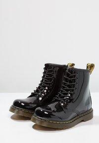 Dr. Martens - 1460 J PATENT - Lace-up ankle boots - schwarz - 2