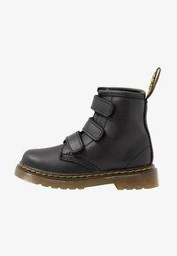 Dr. Martens - 1460 STRAP - Classic ankle boots - black - 1