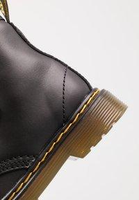 Dr. Martens - 1460 STRAP - Classic ankle boots - black - 2