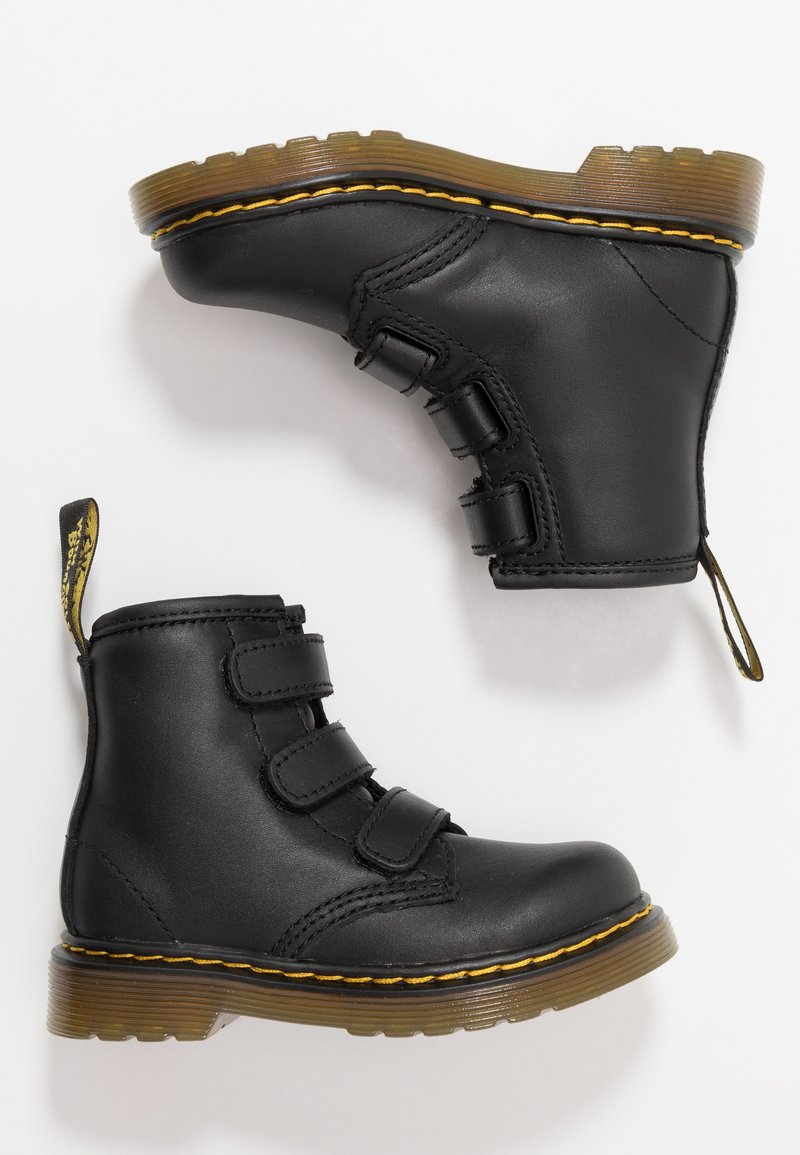 Dr. Martens - 1460 STRAP - Classic ankle boots - black