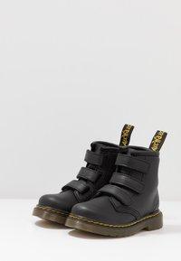 Dr. Martens - 1460 STRAP - Classic ankle boots - black - 3