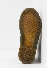 Dr. Martens - 1460 STRAP - Classic ankle boots - black - 5