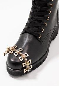 Donna Carolina - Šněrovací kotníkové boty - texas nero - 7