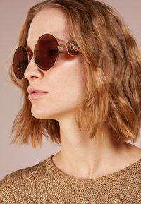 Dolce&Gabbana - Occhiali da sole - gold-coloured - 1