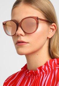 Dolce&Gabbana - Zonnebril - transparent pink - 1